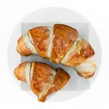 Fresh Croissants, Delicious Breakfast, on plant. Top view. Isolated on white background. 3D Rendering, 3D Illustration Stock Images