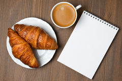 Fresh croissants, espresso and notepad, top view Stock Photo