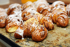 Fresh croissants iced with delicious cream Royalty Free Stock Photos