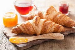 Fresh croissants with jam for breakfast Royalty Free Stock Photo