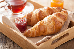 Fresh croissants with jam for breakfast Stock Images