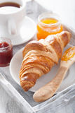 Fresh croissants with jam for breakfast Stock Image