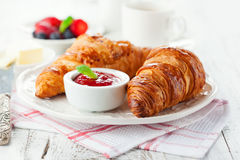 Fresh croissants with jam stock images