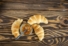 Fresh croissants with jam for breakfast. Top view. Selective focus Royalty Free Stock Photo