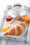 Fresh croissants with jam for breakfast on tray Royalty Free Stock Image