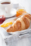 Fresh croissants with jam for breakfast on tray Royalty Free Stock Photography
