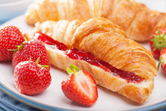 Fresh croissants with jam and strawberry for breakfast Royalty Free Stock Photos