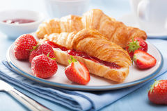 Fresh croissants with jam and strawberry for breakfast Stock Photography