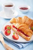 Fresh croissants with jam and strawberry for breakfast Stock Photos