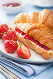 Fresh croissants with jam and strawberry for breakfast Royalty Free Stock Images