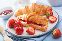 Fresh croissants with jam and strawberry for breakfast Stock Image