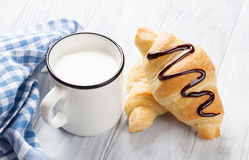 Fresh croissants and milk. On wooden table Stock Photography