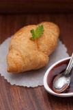 Fresh croissants with mint and strawberry jam Stock Photos