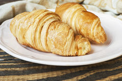 Fresh croissants on a plate. Concept of a breakfast. Selective focus Stock Photo