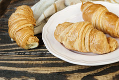 Fresh croissants on a plate. Concept of a breakfast. Selective focus Royalty Free Stock Image