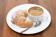 Fresh croissants on a plate and cup of coffee Stock Photo
