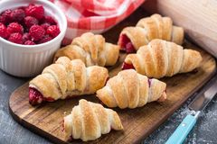 Fresh croissants with raspberries Royalty Free Stock Photography