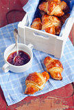 Fresh croissants and rose jam Royalty Free Stock Photos