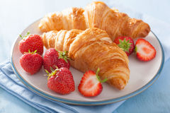 Fresh croissants with strawberry for breakfast Royalty Free Stock Images