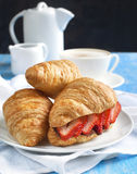 Fresh croissants with strawberry and chocolate nuts cream Royalty Free Stock Image