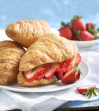 Fresh croissants with strawberry. Stock Photos