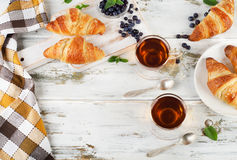 Fresh croissants and two cups of tea Royalty Free Stock Photography