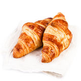 Fresh Croissants on a white linen napkin on white background clo Royalty Free Stock Photography