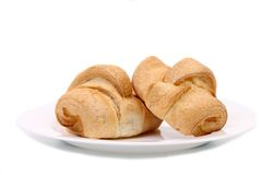 Fresh croissants on white plate. Royalty Free Stock Image