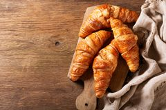 Fresh croissants on wooden board royalty free stock photography