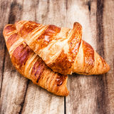 Fresh Croissants on wooden rustic Royalty Free Stock Photo