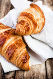 Fresh Croissants on wooden rustic background Royalty Free Stock Photo