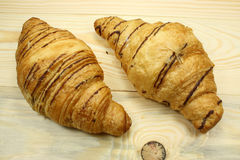 Fresh croissants on a wooden table Stock Images