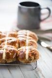 Fresh cross buns for breakfast. On table Stock Photo