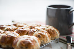 Fresh cross buns for breakfast. On table Royalty Free Stock Photos