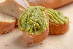 Fresh crunchy avocado cream sandwiches on sliced board stock photography
