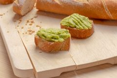 Fresh crunchy avocado cream sandwiches on sliced board stock images