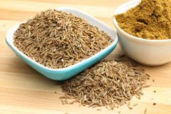 Fresh Crushed cumin. Crushed cumin on wooden background royalty free stock image