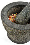Fresh crushed organic spices and pestle Stock Photography