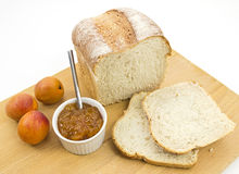 Fresh crusty farmhouse bread with apricot conserve Stock Photos