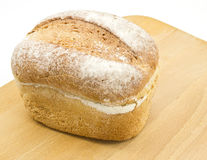 Fresh crusty farmhouse bread on board Royalty Free Stock Photos