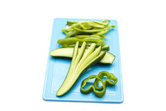 Fresh Cucumber with Bell Pepper. On blue underlay Royalty Free Stock Photo