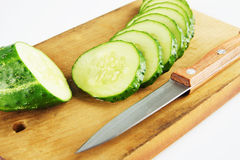 Fresh cucumber on the cutting board. Fresh cucumber on the wooden cutting board Stock Image