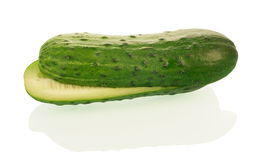 Fresh cucumber fruits with cut isolated on white Royalty Free Stock Image