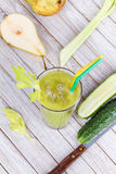 Fresh cucumber, pear and celery juice. Slices of fruits and vegetables Stock Photos