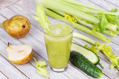 Fresh cucumber, pear and celery juice. Slices of fruits and vegetables Stock Photo