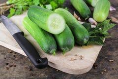 Fresh cucumber, raw organic vegetable. Fresh cucumber on wooden background, raw organic vegetable Stock Images