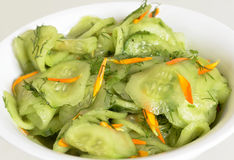 Fresh cucumber salad with carrot stripes Royalty Free Stock Photography