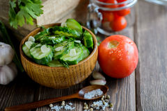 Fresh cucumber salad with fennel and garlic in bowl. On wooden board Stock Photography