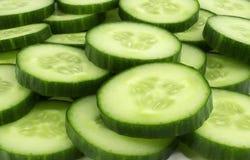 Fresh cucumber slices background. Fresh cucumber slices background, tasty, natural Stock Photo