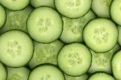 Fresh cucumber slices background. Fresh cucumber slices background, tasty, natural Stock Image